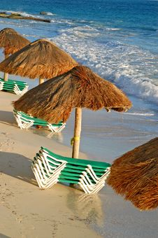 Free Beach Green Chairs , Blue Ocean And Umbrellas Stock Image - 4007561