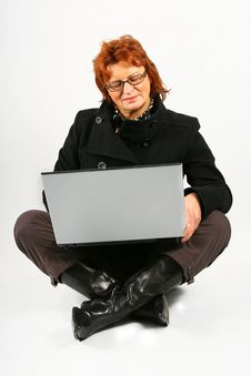 Businesswoman Sitting With Laptop Stock Photo