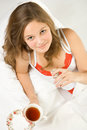 Free Young Girl Drinking Tea In Bed Royalty Free Stock Image - 4012616