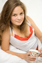 Free Young Girl Drinking Tea In The Bed Stock Image - 4012881