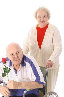 Free Wife Pushing Elderly Husband Stock Image - 4011941
