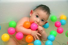 The Child Bathing In A Bath Stock Photo