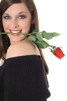 Free Beautiful Brunette With A Rose In Her Mouth Royalty Free Stock Image - 4016216