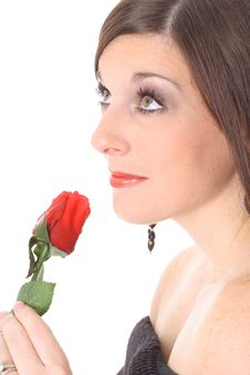 Free Brunette Smelling A Rose Looking Up Royalty Free Stock Photos - 4016268