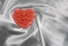 Free Heart-shaped Candle On White Satin Royalty Free Stock Photos - 4017888