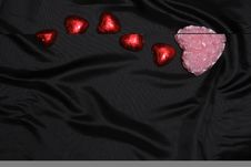 Free Heart-shaped Stuff On Balck Satin Royalty Free Stock Photo - 4017895
