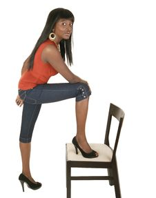 Free Fashion Girl Stepping On Chair Stock Image - 4019861