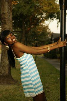 Free Outdoor Portrait Of Girl Swing In Pole Stock Images - 4019934