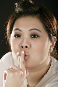 Portrait Of Asian Girl Doing Quiet Sign Stock Photos