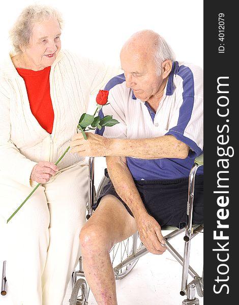 Wife giving handicap husband a rose vertical