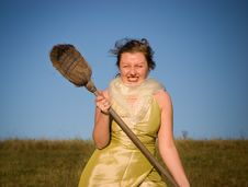 Free Witch Hiting With Broom Stock Photo - 4020730