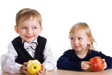 Girl And The Boy With An Apple Stock Photos
