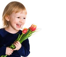 Free Little Girl With A Tulips Stock Photos - 4023803