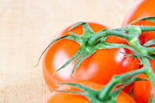 Free Tomatoes On The Vine On A Wooden Chopping Block Stock Image - 4024761