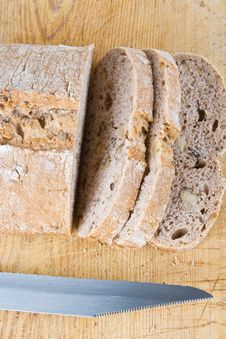 Free A Fresh Bread Loaf With A Knife Stock Photos - 4024843