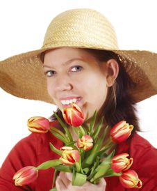 Woman With Tulips And Strawhat Stock Images