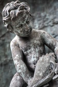 Free Statue Of Boy Looking At Seashell Stock Photo - 4028730