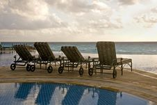 Free Chaise Lounges Facing Beach Stock Photos - 4028923