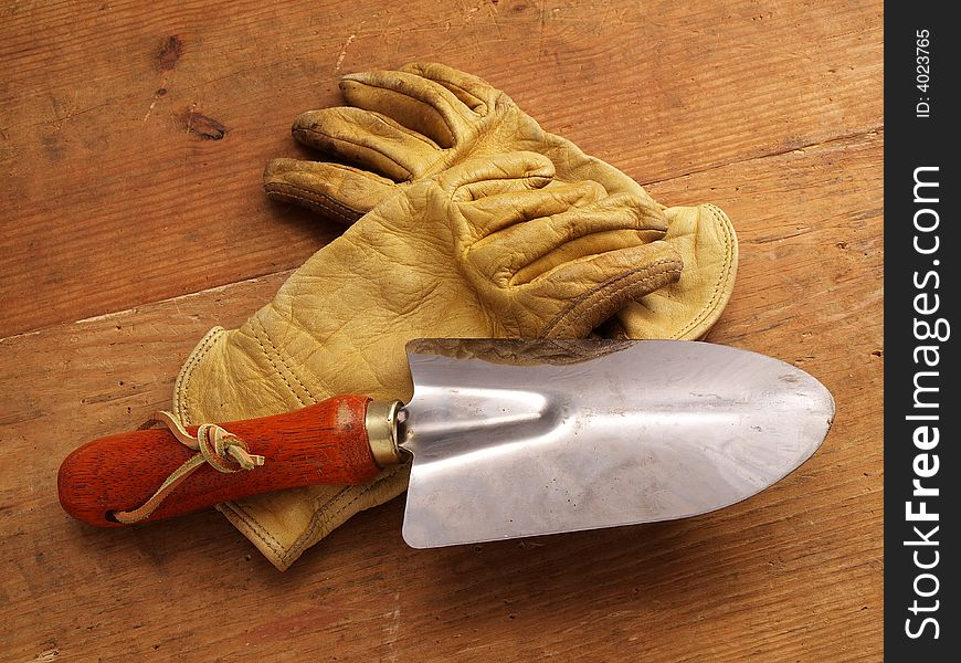 Work gloves on wood with hand tool 1