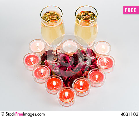 Free Heart From Burning Candles With Two Glasses Stock Photos - 4031103
