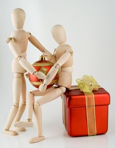 Free Two Wooden Little Men With Cristmas Toys Royalty Free Stock Photography - 4030907
