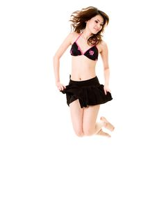 Happy Cheerleader Jump Stock Photo