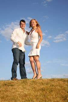 Free Couple Stand On Meadow Royalty Free Stock Image - 4034736