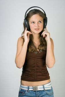 Free Young Pretty Girl Listening Music With Headphones Stock Photos - 4034793