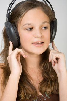 Free Young Pretty Girl Listening Music With Headphones Royalty Free Stock Image - 4034806