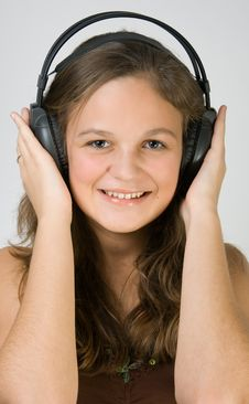 Free Young Pretty Girl Listening Music With Headphones Stock Images - 4034814