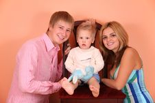 Free Parents With Child On Chair Royalty Free Stock Images - 4039349