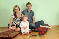 Free Family Sit On Floor On Pillow Royalty Free Stock Photo - 4039755