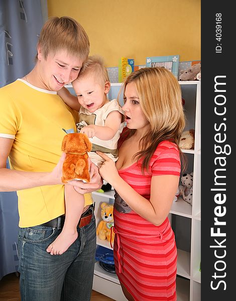 Parents hold child on hands