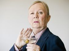 Dramatic Senior Woman With A Martini Stock Photo