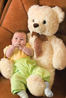Free Baby With A Toy Bear Royalty Free Stock Photo - 4045175
