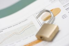Stock Market Graph, Portfolio And Open Padlock Royalty Free Stock Image
