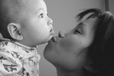 Free Mother Kisses Baby Son. Royalty Free Stock Photos - 4050518