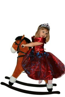 The Little Girl On A Toy Horse Royalty Free Stock Photos