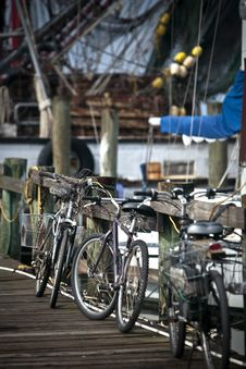 Bikes Lined Up And Leaning On The Railing Royalty Free Stock Photography