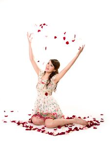 Free Young Girl Tossing Rose Petal Stock Image - 4059361