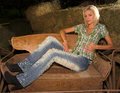 Free Blond Lady Sitting Sideways On Cart Royalty Free Stock Photography - 4063887