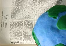Crude Earth Globe On Bible Royalty Free Stock Image