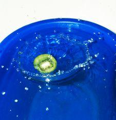 Free Slice Of Kiwi Fruit Fallen In Water Stock Images - 4077564