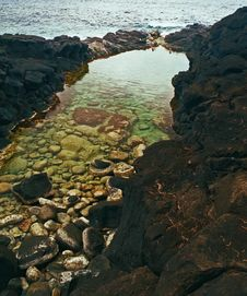 Free Kauai Coastal Black Lava Rock Pool Stock Image - 4079521