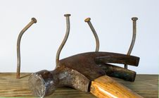 Hammer And Bent Nails Stock Image