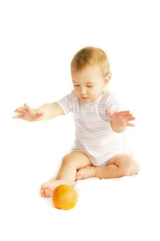 Free Baby Tryinh To Catch An Orange Stock Images - 4083964