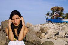 Girl Sitting On Rocky Beach Royalty Free Stock Image