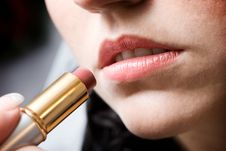 Painting The Lips With The Lipstick Royalty Free Stock Photography