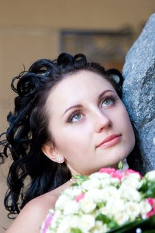 Free A Girl By The Stone Wall With The Bouquet Of Flowe Royalty Free Stock Image - 4088566