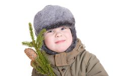 Free A Boy In Winter Coat With A Branch Of Fur Tree Royalty Free Stock Image - 4088756